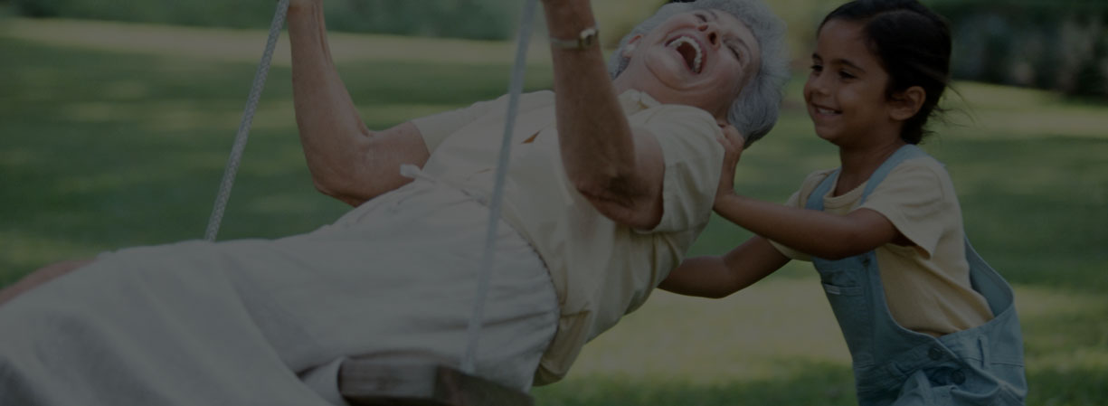 Girl Pushing Abuela On SwingParks Foundation